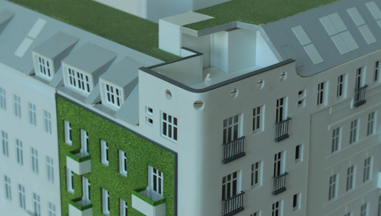Model photo showing the corner solution and communal terrace in the new-build on the corner of Reichenberger Straße 86 in Berlin